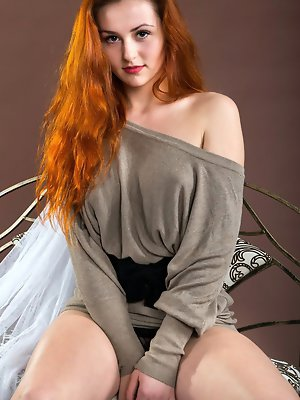 Redhead Sascha showcasing her gorgeous creamy body with beautiful breasts and bares her untrimmed pussy in front of the camera.