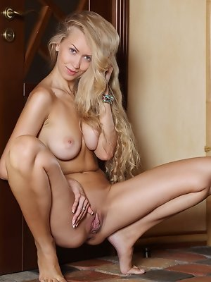 """""""Blue-eyed blonde with pouty lips, slender body, magnificent breasts, and pink, shaven pussy, that is 19-year-old Kaylee A."""""""