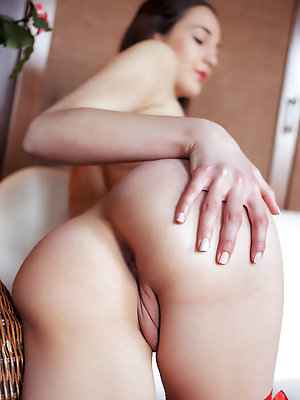 """""""Valensia's flaunts her towering figure with curvy hips, small, puffyy breasts and long,   sexy legs as she poses all over the sofa."""""""